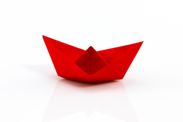 Close up of red origami ship