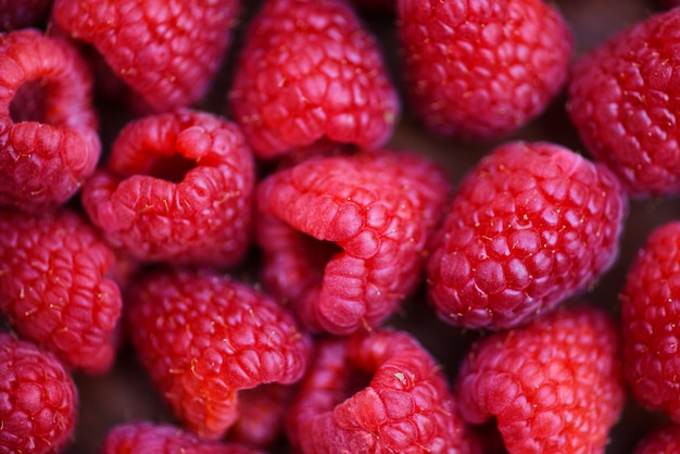 Close up red raspberries fruit background top view