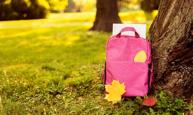 Close up of red school bag outdoors