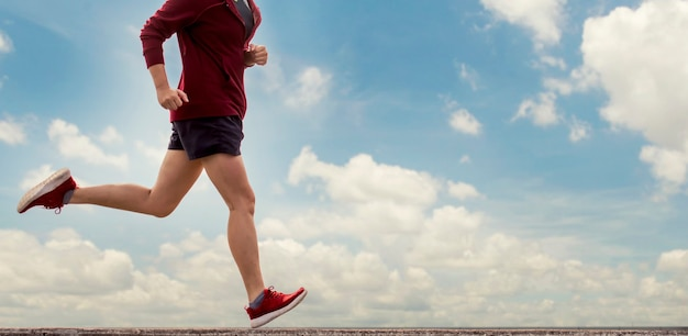 Close up red shoes athlete and cloud sky background