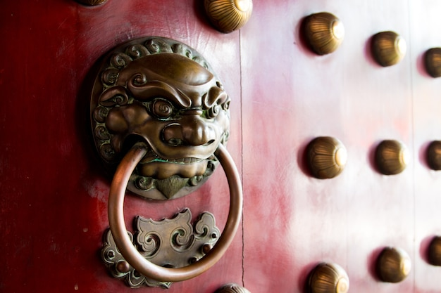 Close-up of red temple door in chinatown, singapore city state