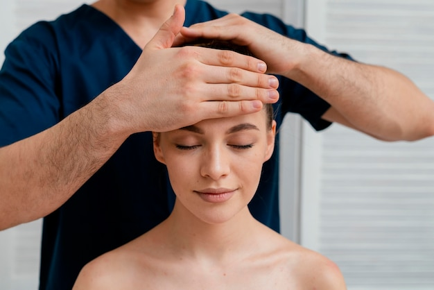 Close up relaxed woman being massaged