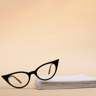 Close-up retro eyeglasses on a book