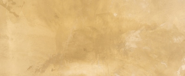 Close up retro plain tan and sepia color cement wall background texture