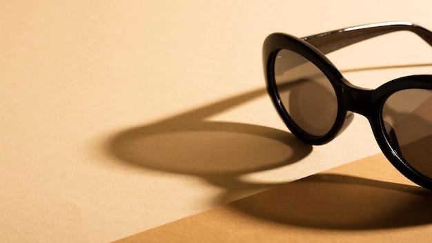 Close-up retro sunglasses with shadow