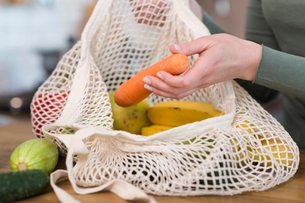 Close-up reusable bag with organic groceries