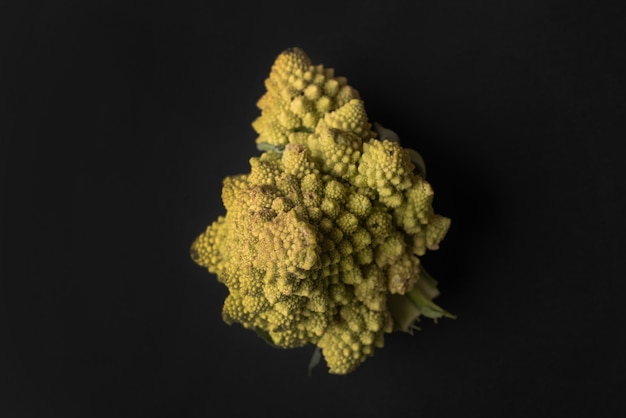 Close up of a ripe cauliflower isolated over black