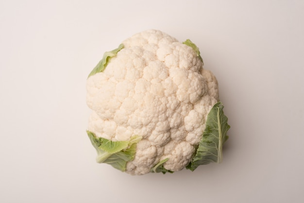 Close up of a ripe cauliflower isolated over white