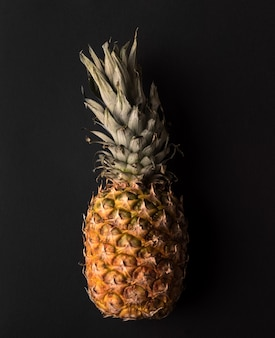 Close up of ripe pineapple isolated over black