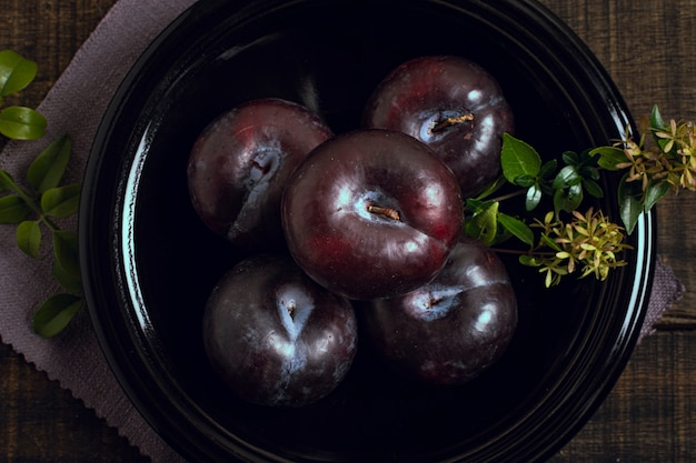 Close-up ripe plum fruit in a bowl