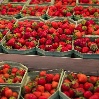 Close-up of ripe strawberries in the display case