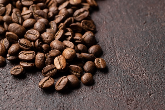 Close-up roasted coffee beans background.