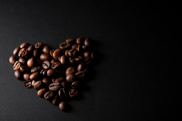 Close-up roasted coffee beans in shape of heart