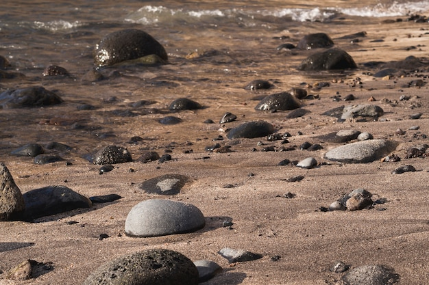 Close-up rocks on wild beach