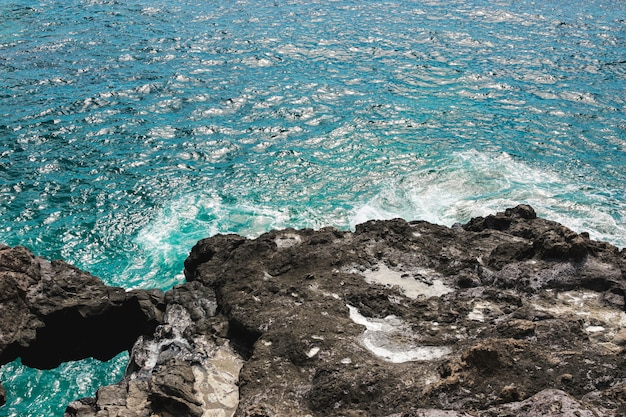 Close up rocky coast with crystalline water