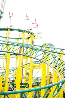 Close-up of roller coaster rail at amusement park