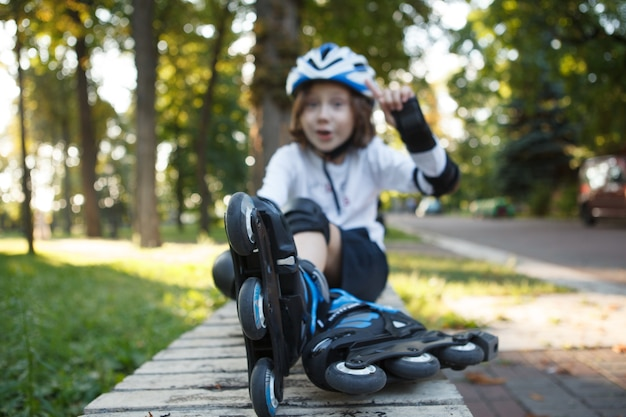 Close up of rollerskates young boy is wearing, relaxing after skating