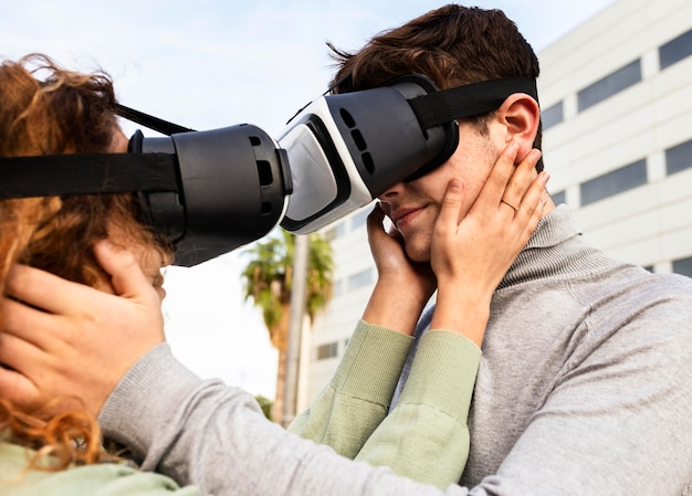 Close-up romantic couple wearing vr glasses
