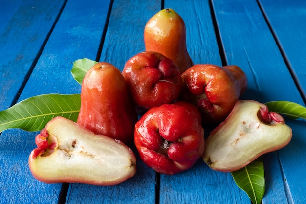 Close up of rose apples on blue wooden table