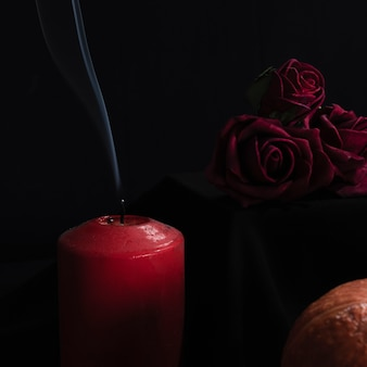 Close-up of roses and candles