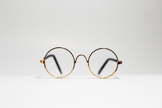 Close-up of round gold eyeglasses isolated on white
