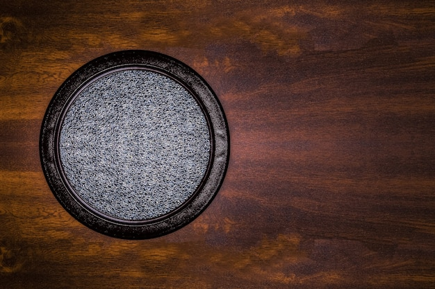Close up on round window on wooden wall