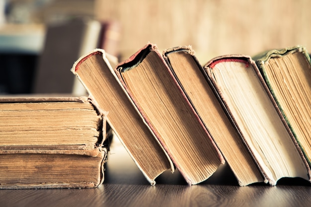 Close up of rows of old books on the table