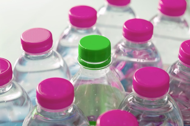 Close up rows and pack of plastic water bottles