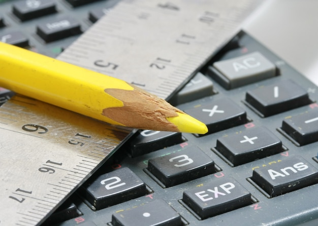 Close-up of ruler,calculator and pencil