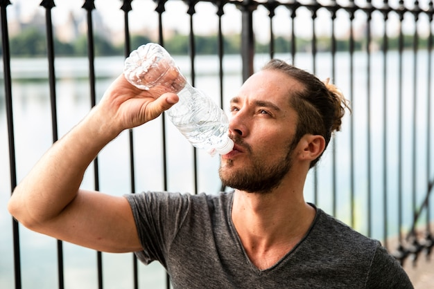 Close-up of runner drinking water