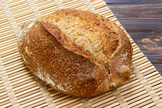 Close up of rustic loaf of bread on wooden table