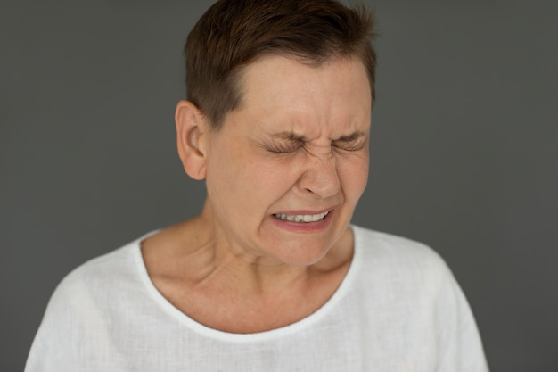 Close up sad woman with closed eyes