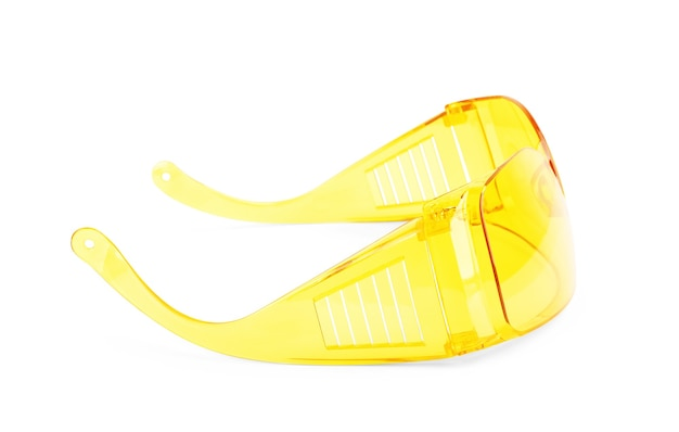 Close-up of safety glasses on a white background