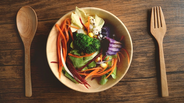 Close up a salad bowl , healthy vegan organic vegatable foods , above or top view overhead shot