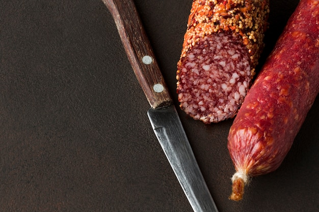 Close-up salami with knife on the table