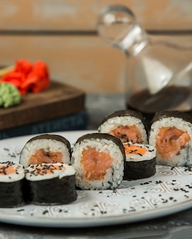 Close up of salmon maki rolls garnished with sesame