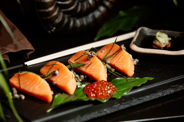 Close up of salmon sashimi served with red tobiko