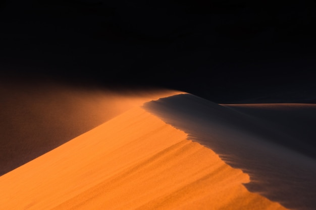 Close up of sand dune moved by the wind , desert of sahara