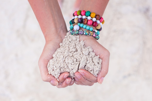 Close-up of sand heart in woman's hands