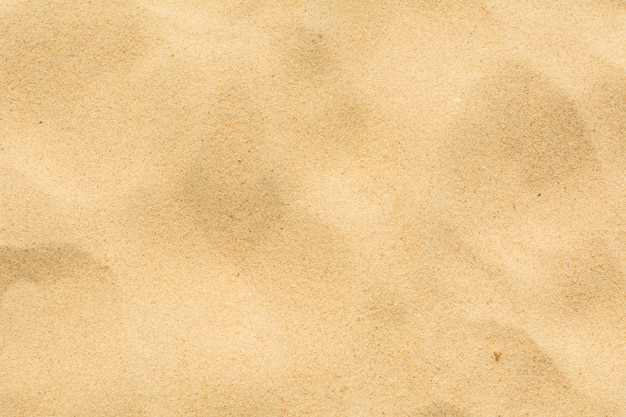 Close-up sand texture on the beach as background
