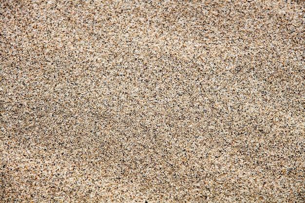 Текстура песка на пляже крупным планом
