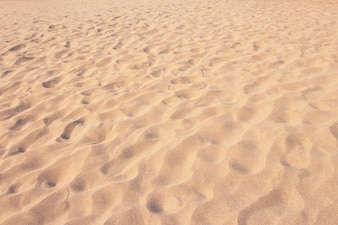 Close up sand texture pattern background of a beach in the summer