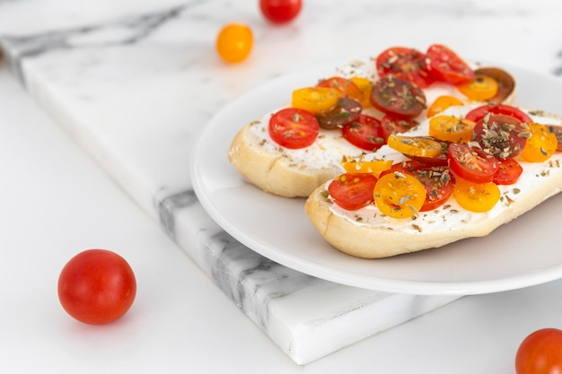 Close-up sandwiches with cream cheese and tomatoes on plate