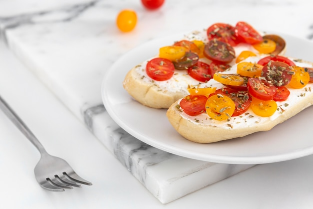 Close-up sandwiches with cream cheese and tomatoes