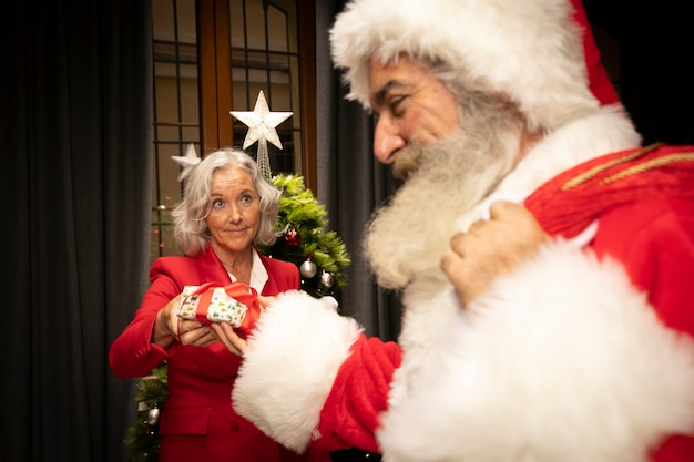 Close-up santa with senior woman