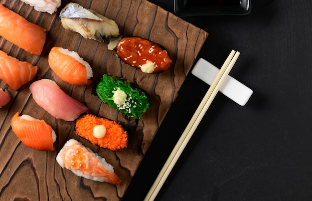 Close up of sashimi sushi set with chopsticks