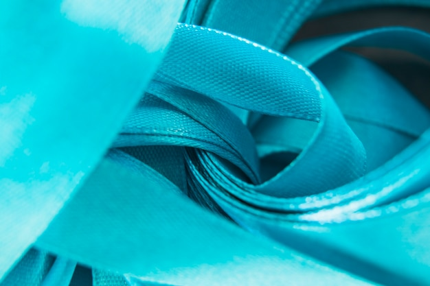 Close-up of satin blue curled ribbon