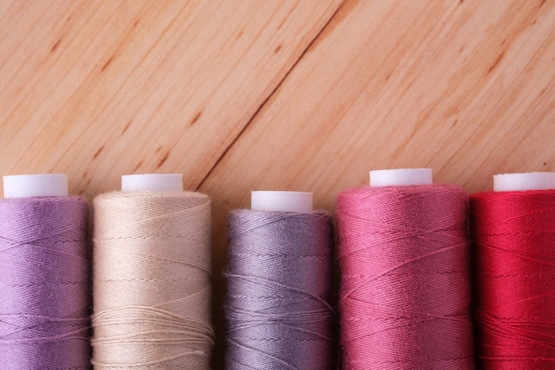 Close up of scattered colorful cotton thread coils