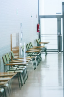 Close-up of school chairs in the university building.