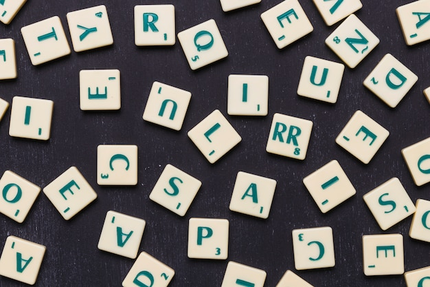Close-up of scrabble letters against black background